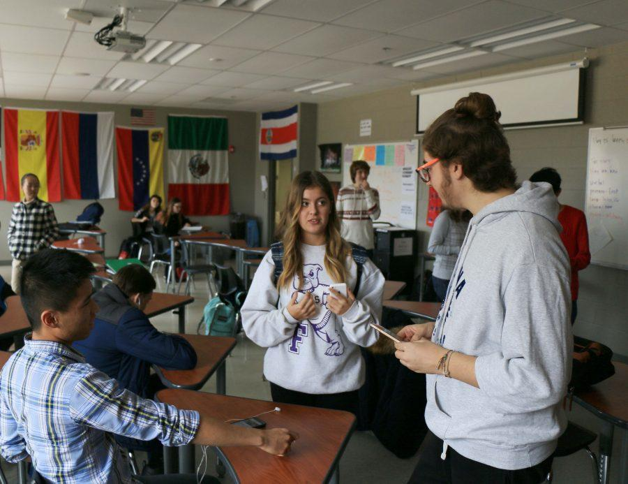 From different parts of the same country, Elena Bustamante and Roberto Grosso discuss their experiences in Spain at the World Language Club meeting on Monday, Dec. 12.