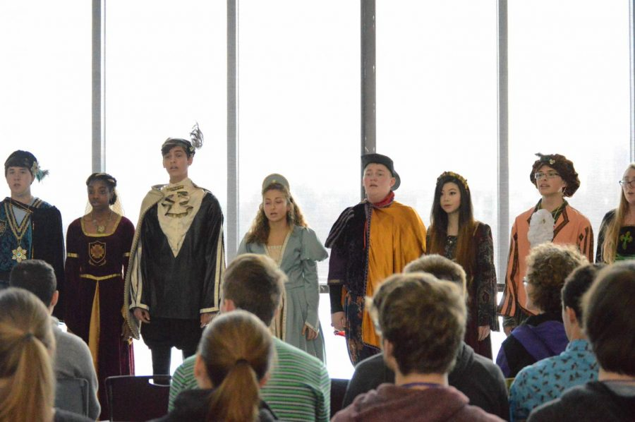 FHS Encore choir preforms a Madrigal feast sampler in the library on Novermber 29.