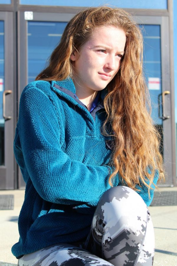 FHS student Madeline freezes outside of school before class begins, in 15*F weather.