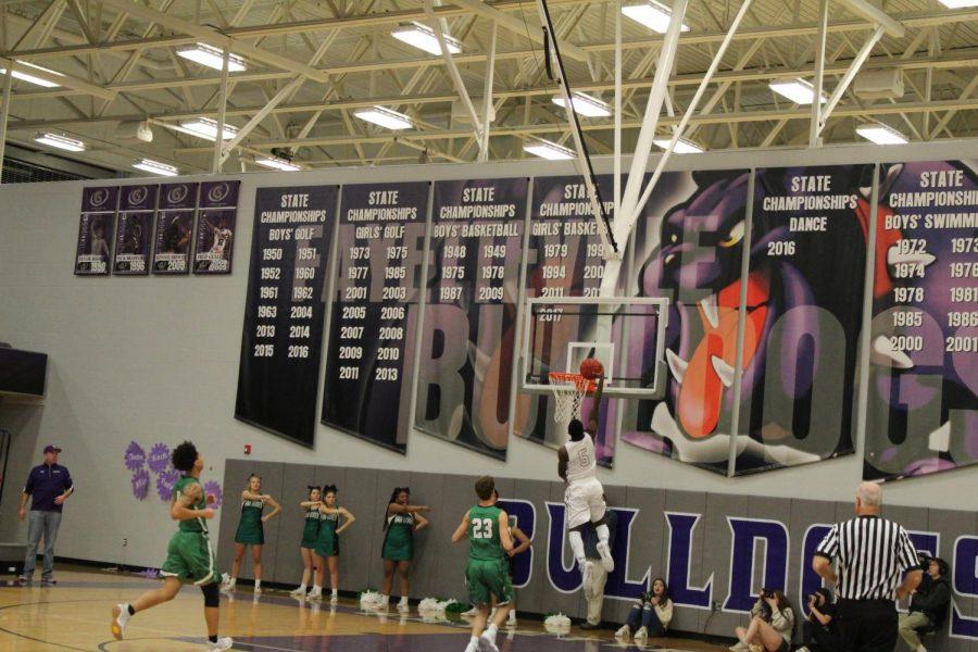 Darius Bowers dunking the ball.