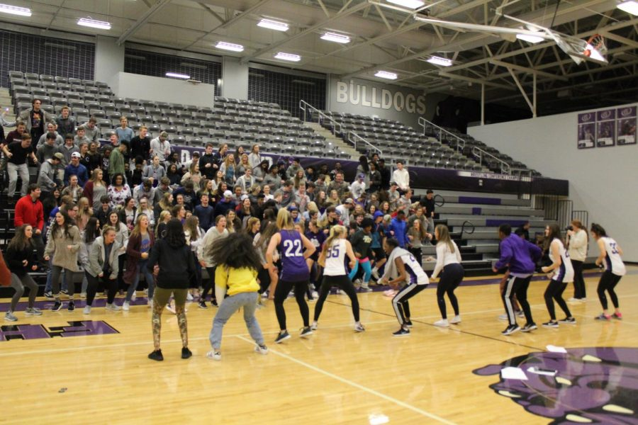 Dawg Crew and FHS students dance to