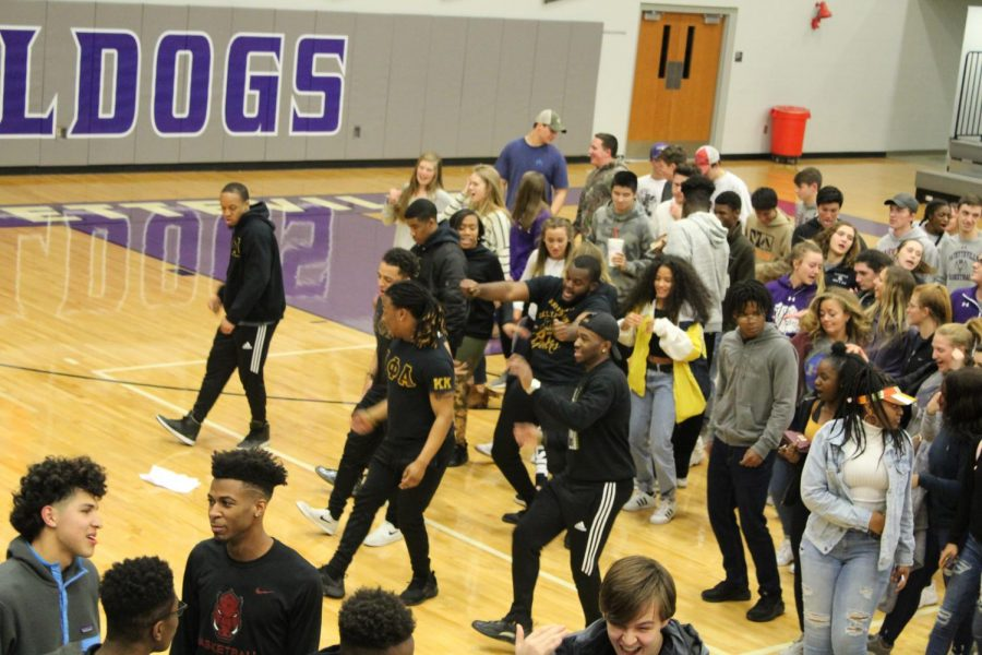FHS students and Alpha Phi Alpha fraternity members end the night by dancing to