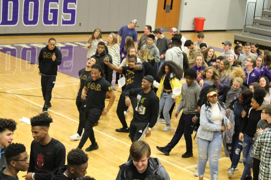 FHS students and Alpha Phi Alpha fraternity enjoy the ending of the HOWL by dancing to popular line dance