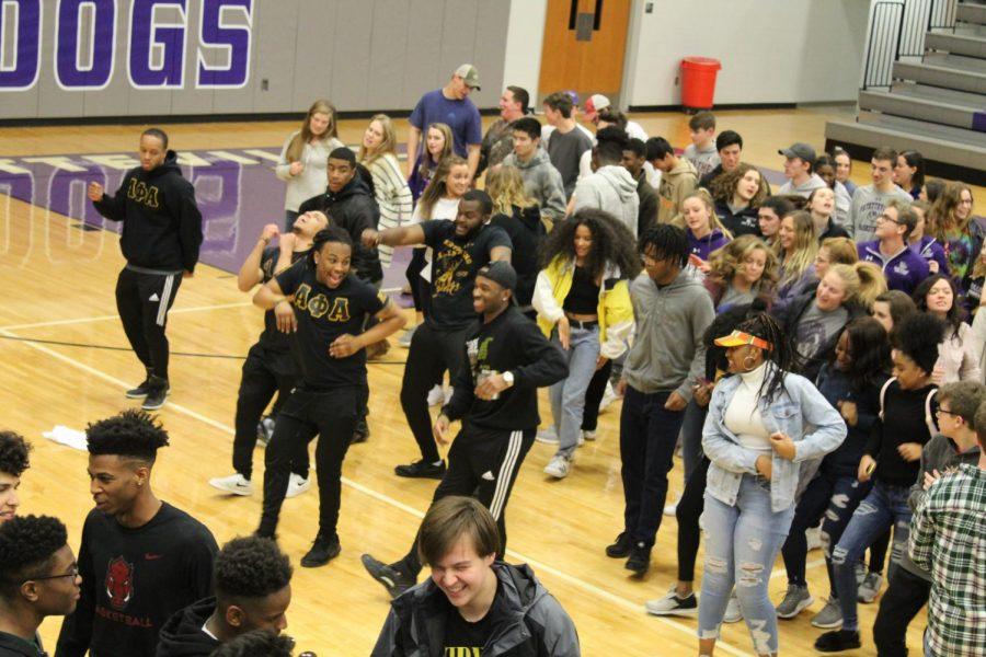 Alpha Phi Alpha fraternity joins FHS studnets in line dance