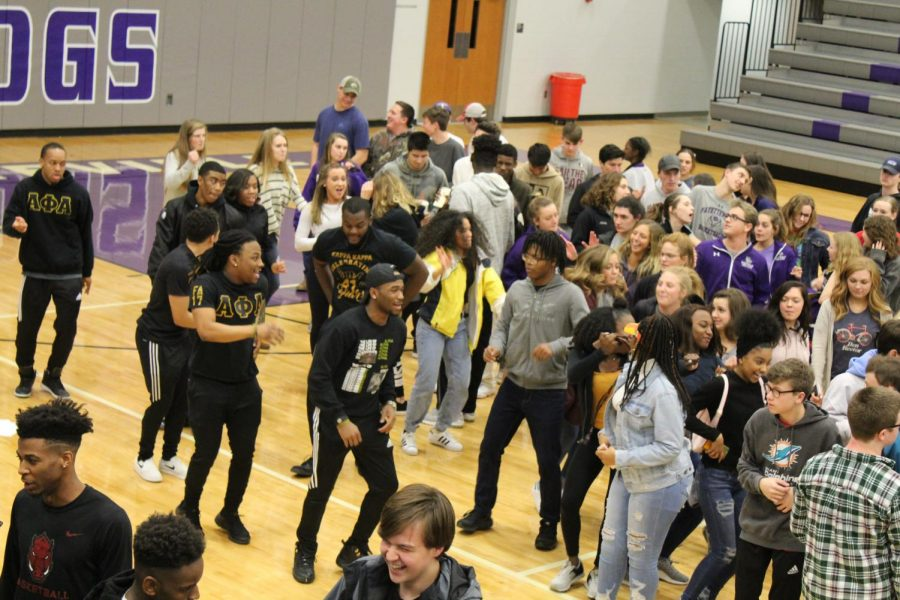FHS students and Alpha Phi Alpha fraternity members dance to line dance