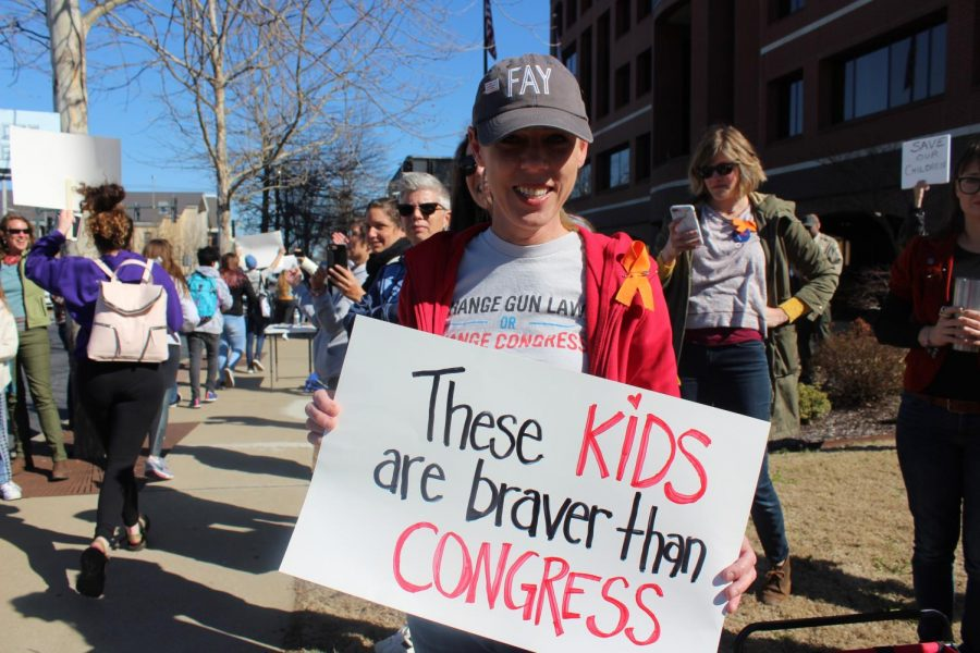 Not satisfied with current legislation, an FHS student holds a sign criticizing lawmakers. Students sent a clear message during the march: legislators need to take concrete action to stop gun violence.