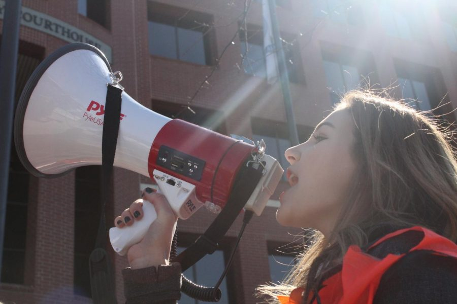 Megaphone in hand, a student leads demonstrators. Students chanted