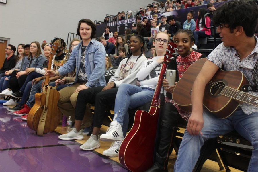 Talent show performers watching Thomas Baker and Carson Haller perform.
