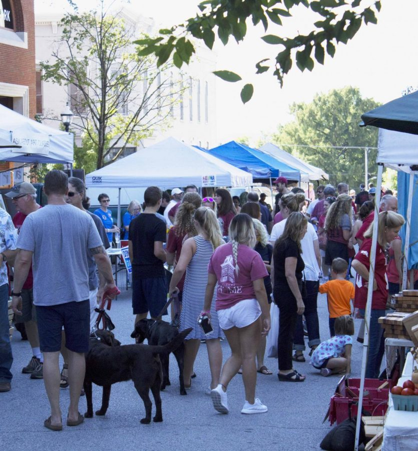 The streets on the square begin to get crowded right before noon. Everyone waking up and heading to the farmers market as a fresh way to start the day.