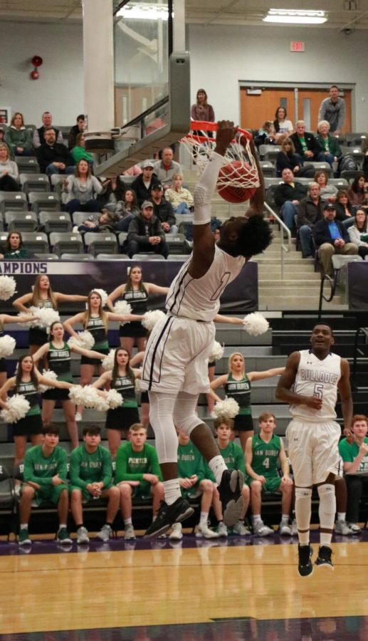 In the first couple minutes of the game, Austin Garrett (11) dunks the ball.