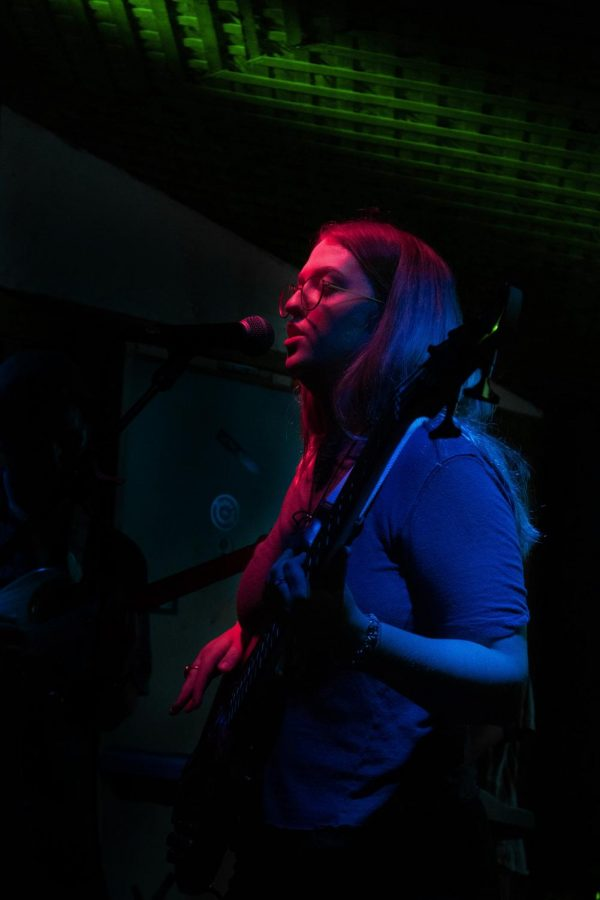 Claire Andress plays guitar for her band Goblin Stomp as they perform cover songs from female artists.
