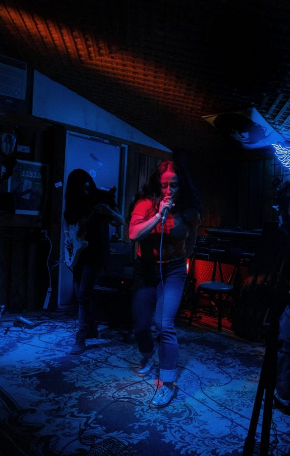 Vocalist for all-female and family band Witchsister, Stephanie Petet starts off the last set of the night at The Roost.