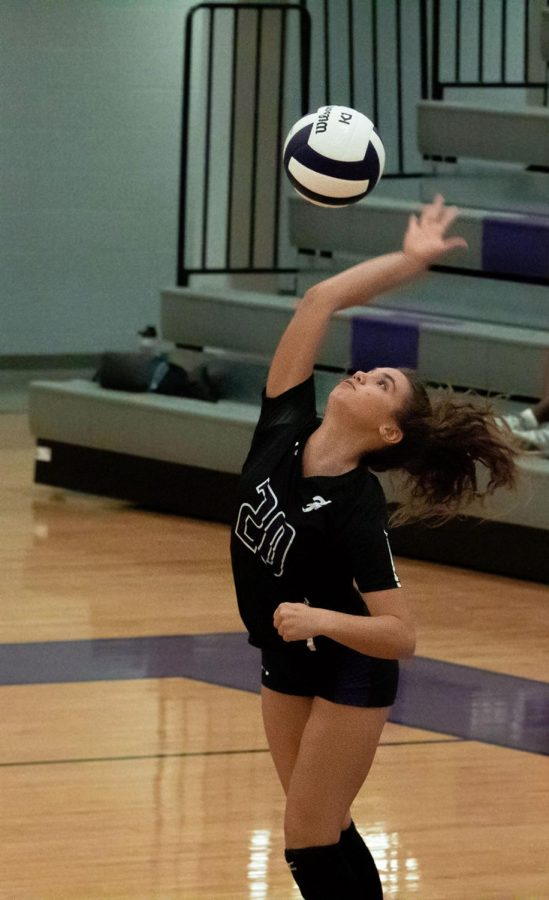 Freshman Ashley Ruff serves for Fayetteville, scoring one of the first points of the set.