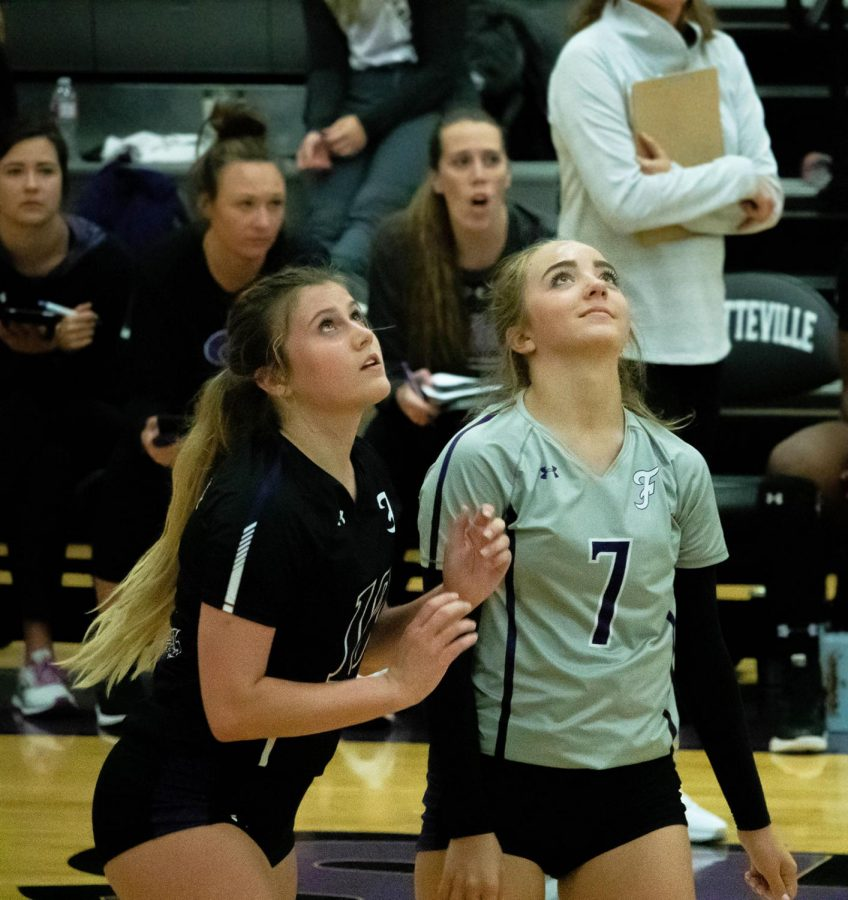 During the third set, Senior Laney Daniels and Junior Gracyn Spresser watch and wait for the ball.