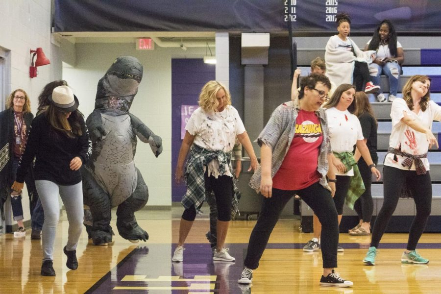 Our zombie teachers walk to out to perform their amazing dance moves for the students.