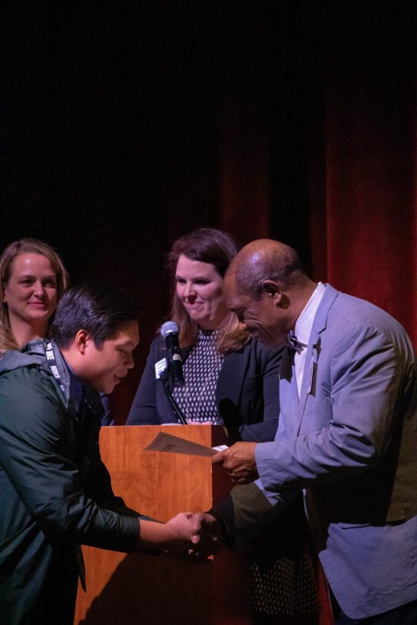 Fayetteville High School's Peter Chu greets Dr. Colbert on the stage before receiving his certificate. Students exiting the ESL programs at their schools were recognized for reaching proficiency in English, and excelling in at least two other subjects.