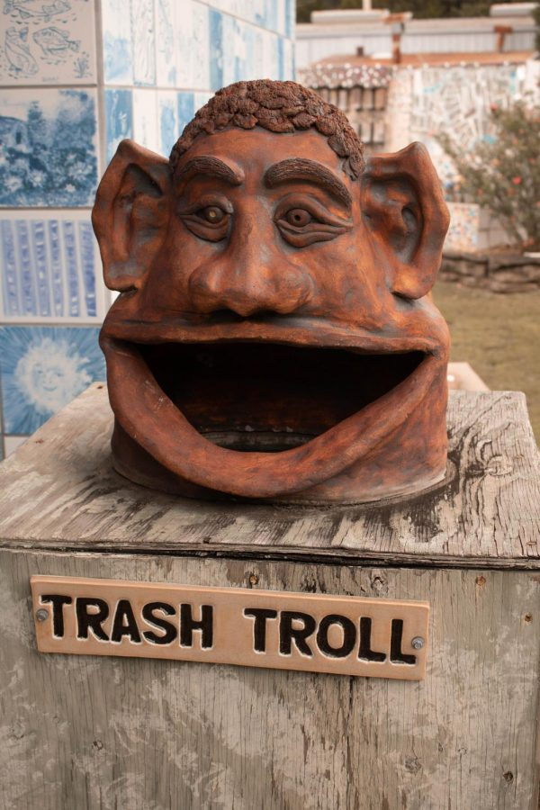 """As part of their mission to create a better present and future, several """"Trash Trolls"""" are on Terra's grounds with signs asking visitors to feed their voracious appetites with any trash patrons have or see."""