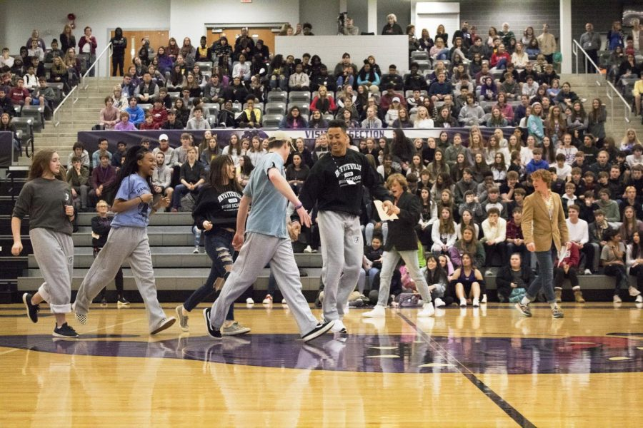 Bulldog Co. members dance across the court to show off the store's new products on January sixteenth.
