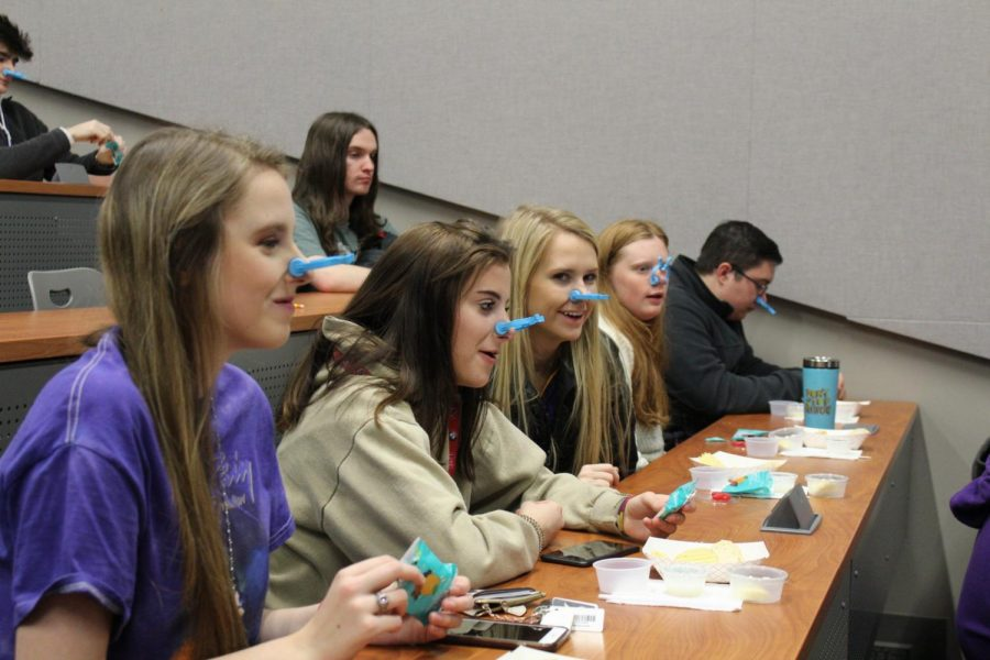 Students on Jan. 24 learn about the importance of taste by trying fruit snacks without the sense of smell.