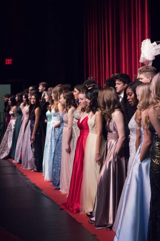 All the student models show off their first set of dresses as the crowd applauds in awe.