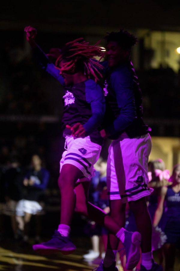 While calling the last of the Fayetteville starting players, Isaiah Askew (12) and Tamaury Releford (11) jump under the lights of Bulldog Arena.