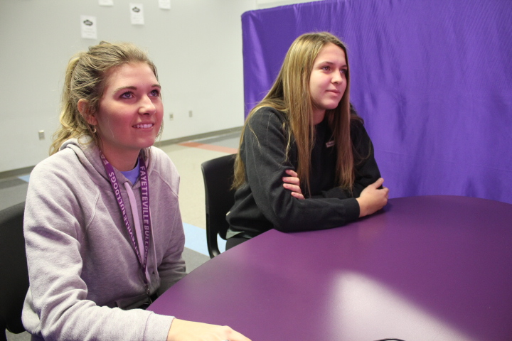Senior Whitney Waitsman takes the Valentines matchmaking project while her friend Emmy Pummil (11) watches Waitsman describe her ideal partner.