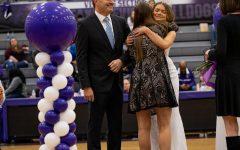 Queen Ryan Jungmeyer hugs former Colors Day Queen Lauren Lofton as Steve Jungmeyer watches.