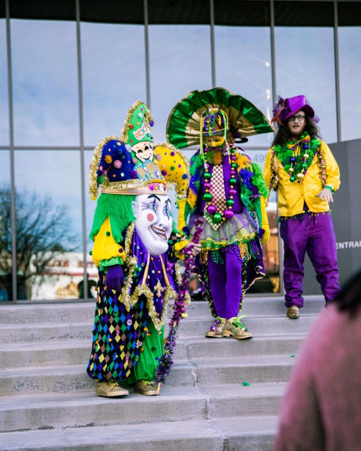 Three citizens stood outside the Walton Arts Center in full costumes so viewers of the parade could get a picture with them.
