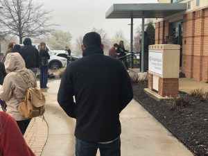 Northwest Arkansas residents practice social distancing while waiting for Fayetteville's CORVID-19 screening clinic to open its doors on opening day.