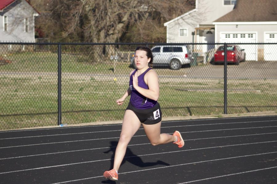 Sophomore Brook Barker finishes her last leg of the 400 meter dash at an impressive minute and eleven seconds.
