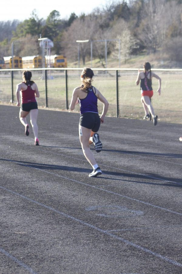 Sophomore Lily Scharnhorst runs the 400 meter dash and finishes at one minute and fifteen seconds.