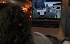 Avery Redfern sits watching Minecraft YouTuber Dream to pass time.